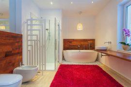 Washing bathroom rugs with towel.