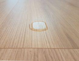 Water on laminate flooring.