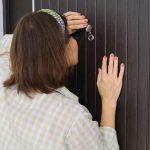 How high to install door peephole.