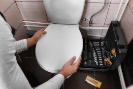 How to fix a toilet seat that keeps falling.