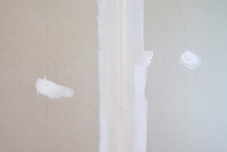 Air bubbles in drywall tape.