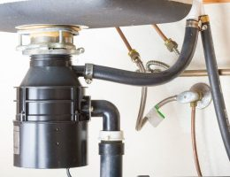 Can the ingredients in commercial drain cleaners damage a garbage disposal system.