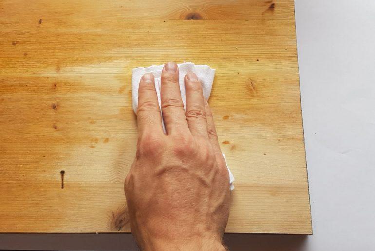 Applying polyurethane with a rag.