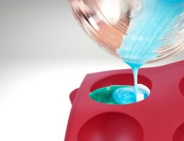 Although epoxy adheres to most surfaces, it doesn't stick to silicone because of the latter's low surface energy.