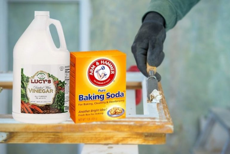 Using home remedies to remove paint from wood.